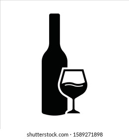 Wine bottle vector icon. Alcohol icon. Alhocol flat sign design. Wine and glass symbol pictogram