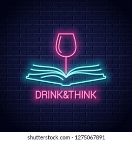 Wine glass with book neon sign. Drink wine read book neon banner on wall background