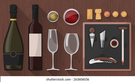 Wine tasting toolkit for wine makers, sommeliers and experts, including wine glass, bottles, corkscrews and assorted objects on wooden background