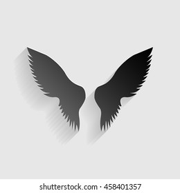 Wings sign illustration. Black paper with shadow on gray background.
