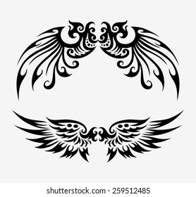 Wings tribal ornament decoration. Black wings elements, good use for tattoo design, illustration element, T-Shirt design, or any design you want. Easy to use, edit, or change color.