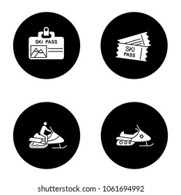 Winter activities glyph icons set. Ski pass badge and tickets, snowmobiles. Vector white silhouettes illustrations in black circles