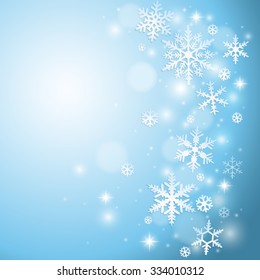 Winter background with snowflakes on blue