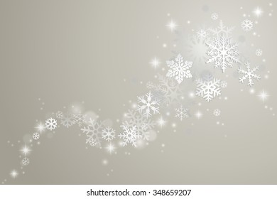 Winter background with swirl of snowflakes and snow on grey