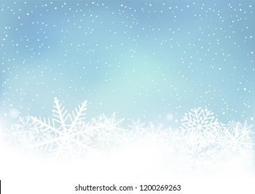 Winter blue sky background with snow. Frosty close-up wintry snowflakes. Ice shape pattern. Christmas holiday decoration backdrop