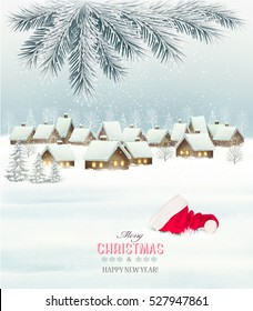 Winter christmas background with a snowy village landscape and santa hat. Vector.
