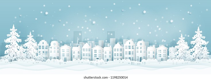 Winter city with houses, buildings and Christmas tree, Christmas card in paper cut style vector illustration