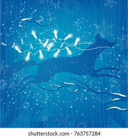 Winter concept Leaping Fox, White Christmas Lights on Blue starry Background and snow-covered branches