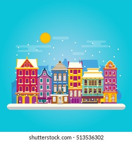 Winter day in cosy town street scene. Classic European houses landscape with Christmas holiday decorations. Snowfall on Christmas eve. Buildings and facades