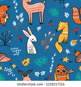 Winter forest seamless pattern with cute animals on blue background.