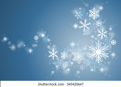 Winter holiday background with swirl of snowflakes on blue