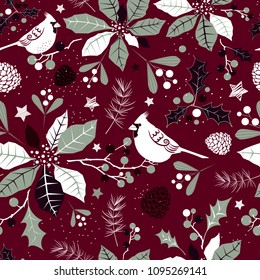 Winter holiday seamless background with stylized flowers of poinsettia, holly berries, cardinal birds, mistletoe sprigs and pine cones