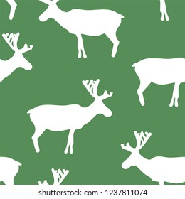 Winter holiday seamless pattern with vector green and white scattered reindeer. Ideal for wrapping paper/ gift-wrap, fabric/textile, wallpaper, packaging, home decor.