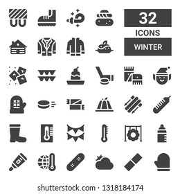 winter icon set. Collection of 32 filled winter icons included Mitten, Rubber, Cloudy, Skate, Thermometer, Feeder, Tire, Garland, Boots, Skii, Pudding, Scarf, Puck, Elf, Hockey