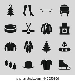 Winter icons set. set of 16 winter filled icons such as pine tree, hat, woman boots, jacket, winter hat, christmas tree, hockey, hockey puck, snowflake, fireplace, skating