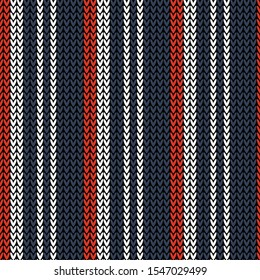 Winter knitted pattern background. Seamless dark and bright knit texture in blue, red, and white with vertical stripes for scarf, hat, top, bag, socks, or other modern winter holiday textile print.