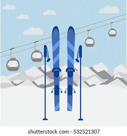 Winter landscape with mountain background, blue sky, moving gondolas, ski and sticks