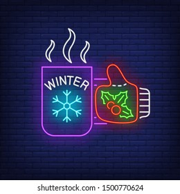 Winter neon lettering on hot tea cup held by hand in mitten. Winter season, Christmas, frost design. Night bright neon sign, colorful billboard, light banner. Vector illustration in neon style.