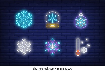 Winter neon sign set with snowflakes, bauble, thermometer, snow globe. Vector illustration in neon style for topics like December holidays, Christmas, snowfall