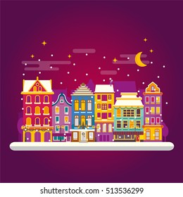 Winter night in cosy town street scene. Classic European houses landscape with Christmas holiday decorations. Snowfall on Christmas eve. Buildings and facades