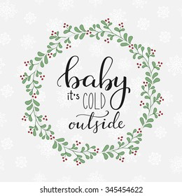 Winter romantic lettering. Calligraphy winter postcard or poster graphic design lettering element. Hand written calligraphy winter romantic postcard. Baby its cold outside. Cute vector flower wreath