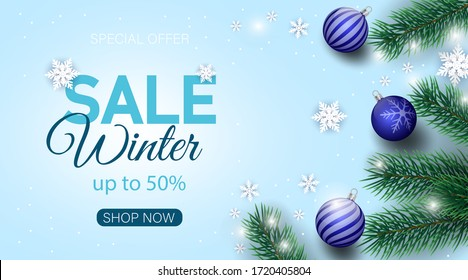 Winter sale banner decorated with Christmas tree branches and snow.