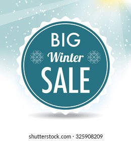 Winter sale blue label with blurred snow background.