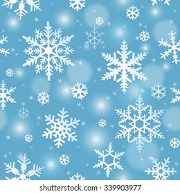 Winter seamless pattern with snowflakes on blue background