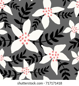 Winter seamless pattern with white poinsettias and black branches on gray background.