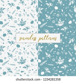 Winter set of 2 blue and white seamless patterns for wrapping paper. Patterns with snowflakes and silhouettes of botanica