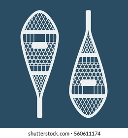 winter sports and outdoor activities equipment: pair of indian traditional snowshoes isolated on a blue background. vector eps-10