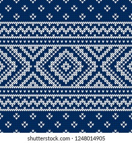 Winter sweater fairisle design. Seamless christmas and new year wool knitting pattern. Vector illustration with aztec motifs. Holiday traditional background.