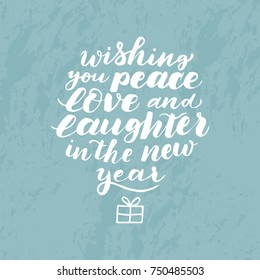 Wishing you peace, love and laughter in New year. Vector isolated white hand drawn text calligraphic. Design for card, print, poster.