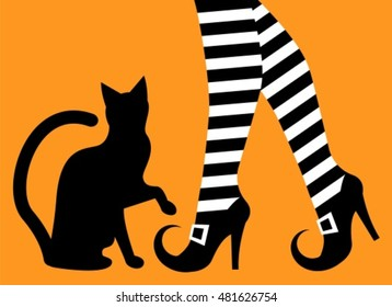 witch legs in striped stockings and shoes with buckles and a silhouette of a black cat on an orange background
