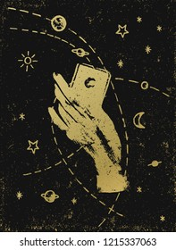 Witch's hand with symbolic cosmos illustration, gold on black textured background. Tattoo, sticker, patch or poster print design.