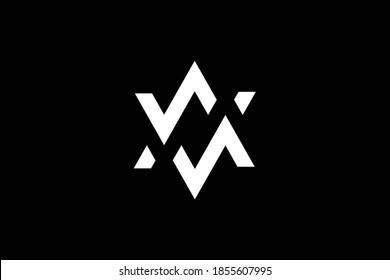 WM letter logo design on luxury background. MW monogram initials letter logo concept. WM icon design. MW elegant and Professional white color letter icon design on black background. M W