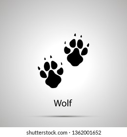 Wolf paws, steps imprints, simple black silhouette on gray