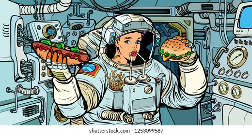 Woman astronaut eats in a spaceship. Cola, hot dog and Burger fast food. Pop art retro vector illustration kitsch vintage