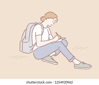 A woman with a backpack sat on the ground and is writing something on her notebook. hand drawn style vector design illustrations.