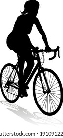 A woman bicycle riding bike cyclist in silhouette