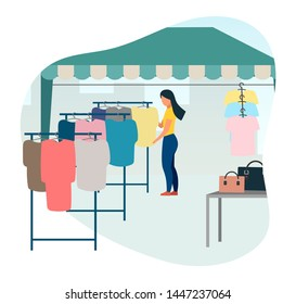 Woman buying clothes at street market flat vector illustration. Trade tent, fair awning. Buyer at outdoor local clothing store, shop cartoon character. Market tent with second hand clothes racks