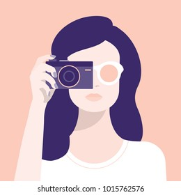 A woman and a camera. Photographer. Avatar of the girl. Portrait of a professional. Vector illustration