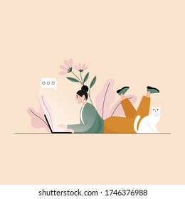 Woman chatting and lying on the floor with laptop and her cat. Flat vector illustration.