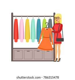Woman choosing dress during shopping, beautiful girl buying clothing colorful vector illustration