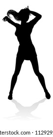 A woman dancer dancing in silhouette