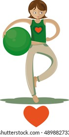 Woman doing exercise using a pilates ball