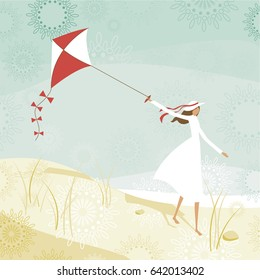 Woman flying a kite on the beach