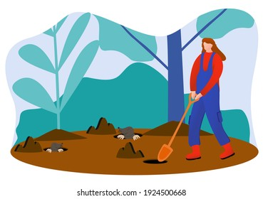 A woman gardener looking for some mole that digging a hole in the ground with a shovel
