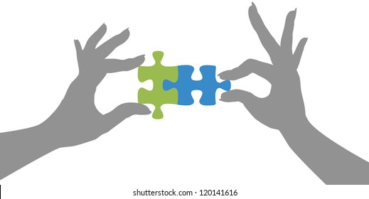 Woman hands holding two jigsaw puzzle pieces together to find a solution