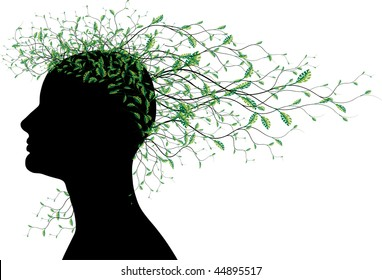 Woman head silhouette with tree branches with green leaves as hair